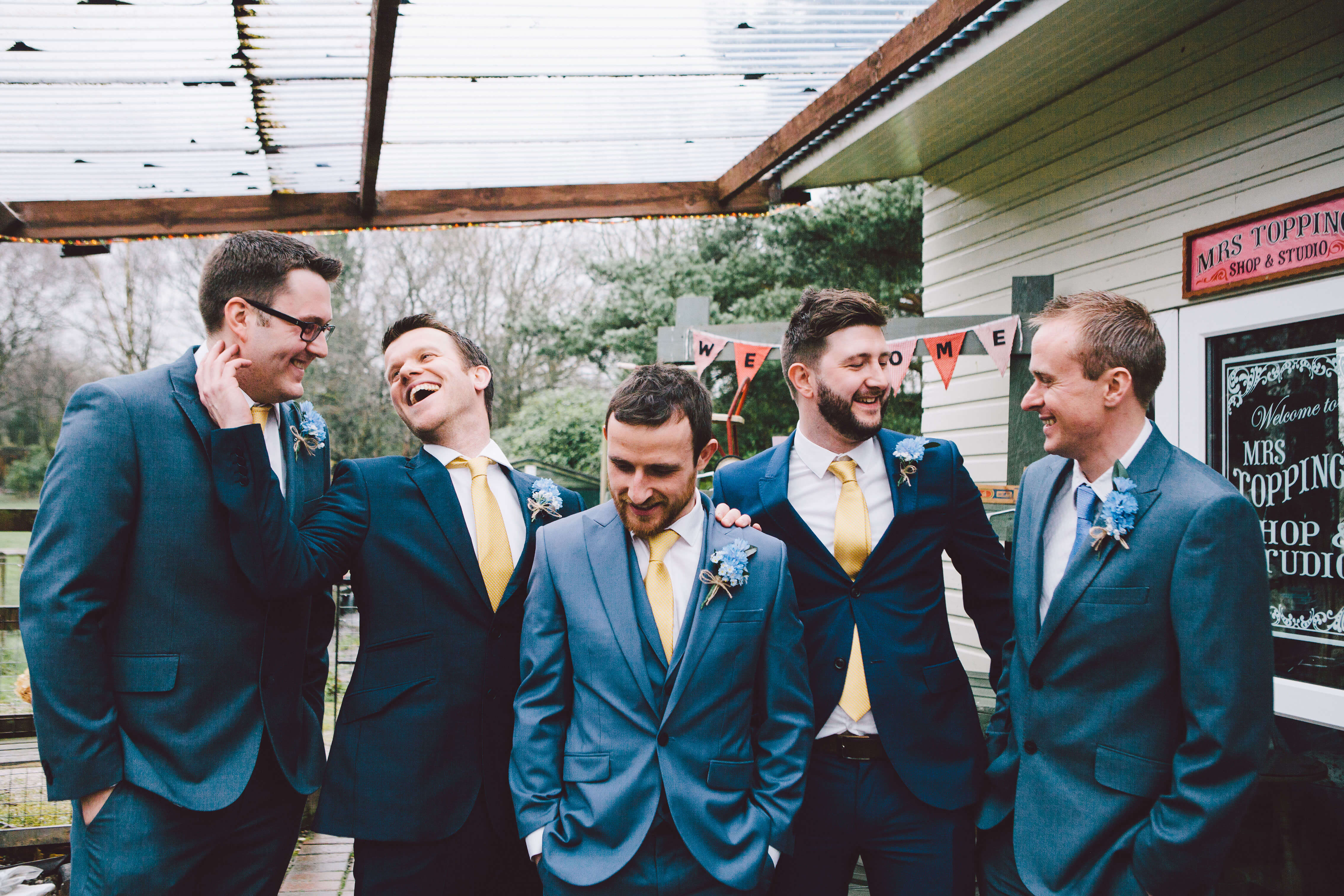 Funny groomsmen group photo at wedding