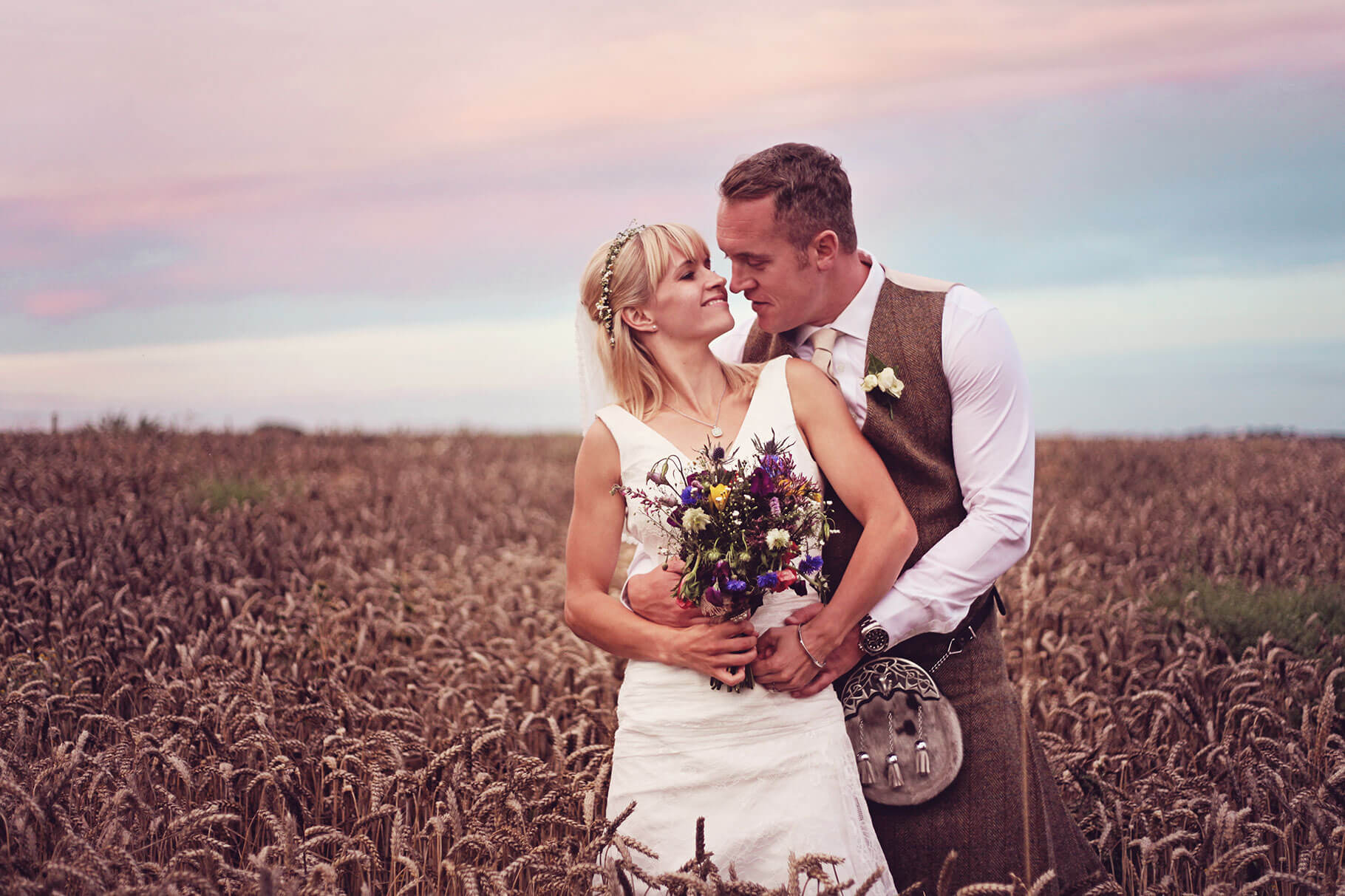 Sunset Wedding Photography of Bride and Groom in Crop field