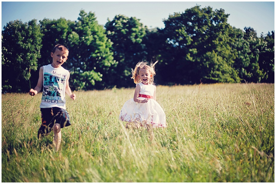 Professional photo of children running in a field