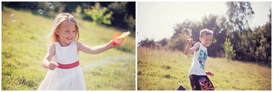 Photograph of child in field playing with bubbles