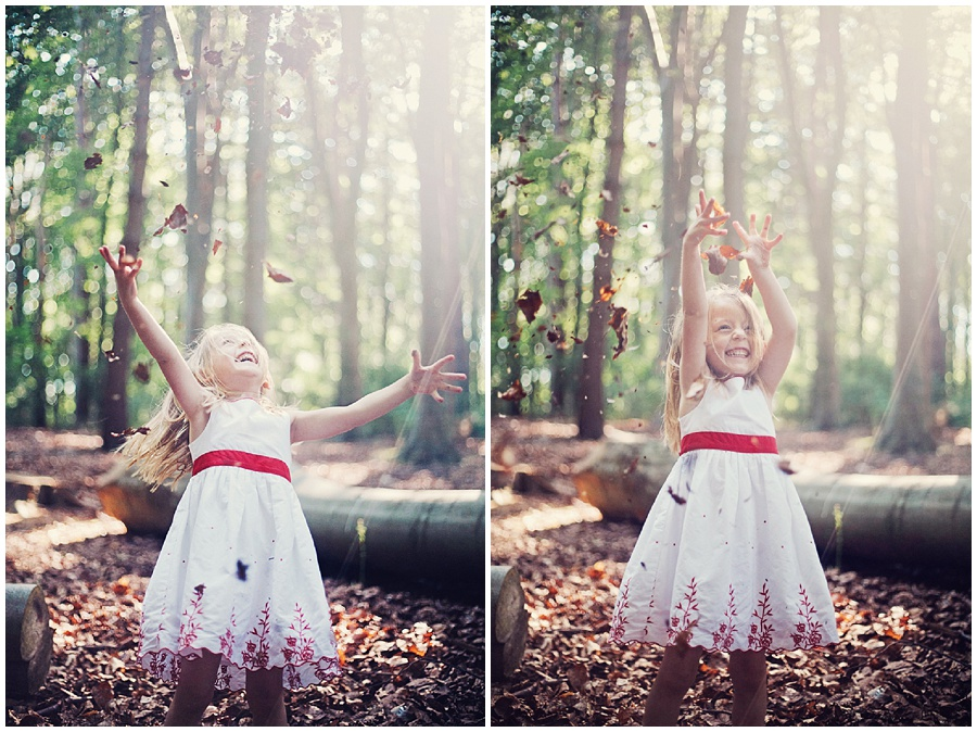 Professional picture of child throwing leaves in the air